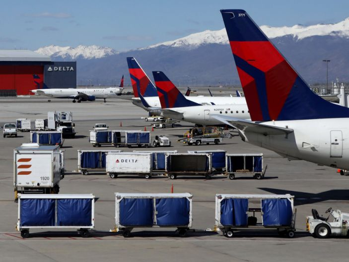 """Delta Airlines planes are loaded and unloaded at Salt Lake City International Airport in Salt Lake City <p class=""""copyright"""">Reuters</p>"""