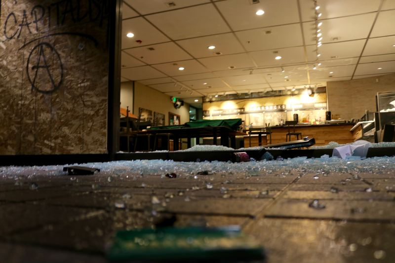 PMG PHOTO: ZANE SPARLING - Broken glass and damage is shown at a Starbucks inside the Standard Insurance building in downtown Portland on Jan 1.