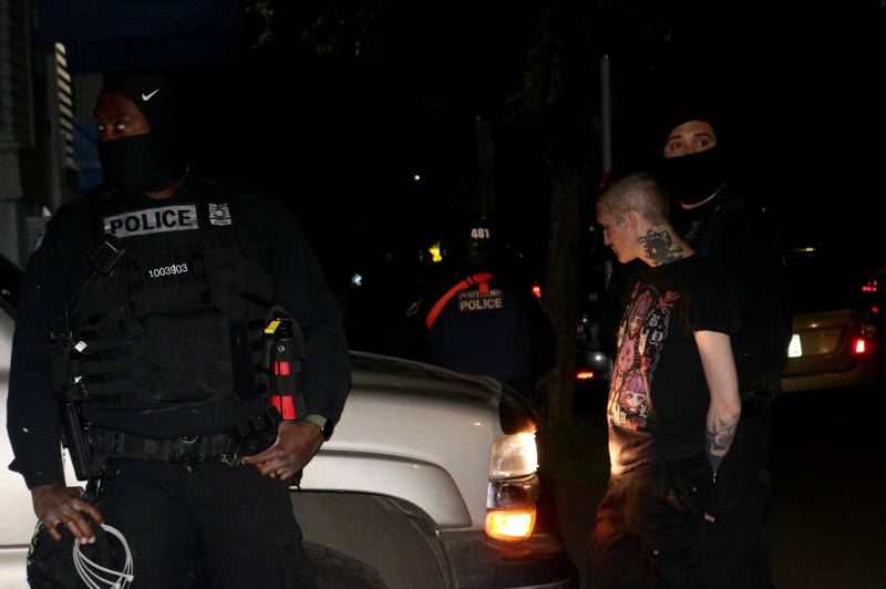 PMG PHOTO: ZANE SPARLING - A person was arrested during a protest in Northwest Portland on Friday, April 23.